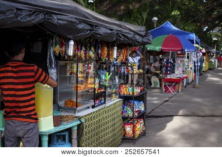 Dumaguete, The Philippines - 27 July 2018: Cheap Snack Shop Seller On Local Market. Street Food Sell