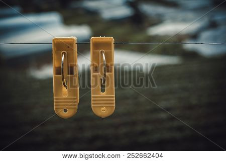 Couple Plastic Clothes Peg. Royalty High Quality Stock Photo Of Two Yellow Plastic Clothes Peg Cloth