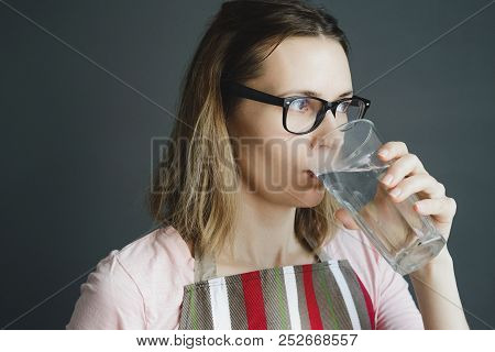 Girl In Glasses Drinks Water From Glass, Close-up Portrait Of White Caucasian Woman, Stock Photo Ima