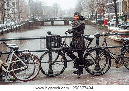 Girl On A Bicycle On The Bridge
