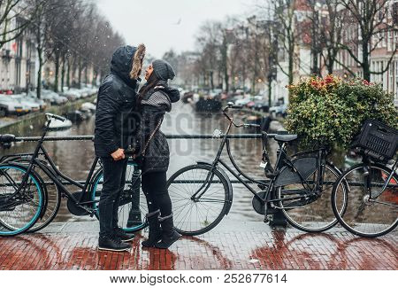 Guy And Girl In The Street In The Rain