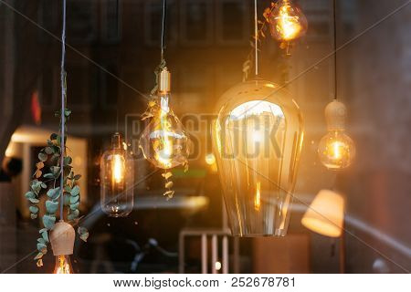 Incandescent Lamps In Room Behind The Glass