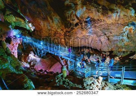 Fluminimaggiore, Sardinia, Italy - August 07, 2018: Tourists Visit The Cave Of