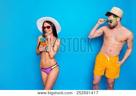 Glance Over The Glasses. Tanned Man Looks At The Dark Haired Cute Girl In A Colorful Bikini Whistlin