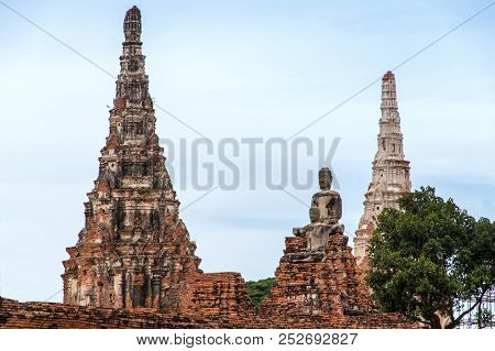 An Ancient Ruin Of Statue Buddha And Pagoda In Historical Park Of Ayutthaya.the Favorite Historical