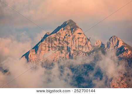 Mountain Peak In The Morning. Extreme Terrain In Alps.
