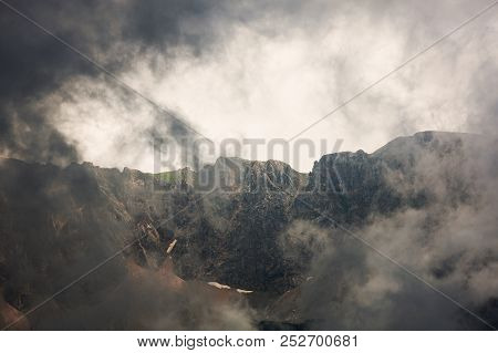 Mountain Range During Storm. Extreme Terrain In Alps.