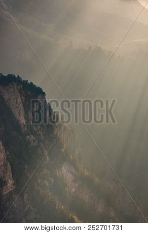 Sunbeam On Mountain Cliff In Afternoon. Extreme Terrain.