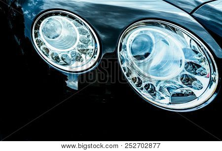 Closeup Detail Of Led Headlight Luxury Car. Beautiful Modern Elegance Headlamp Car. Black Automobile