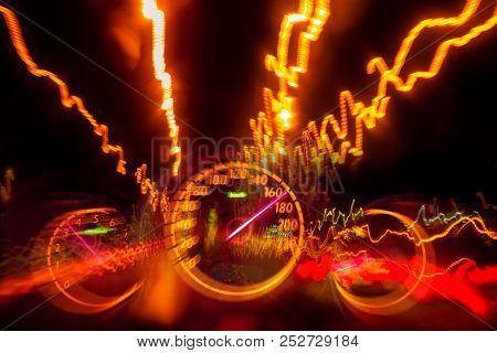 High Speed Road Drive On Night Highway Light Trail With Auto Gauge Speedometer Blurry