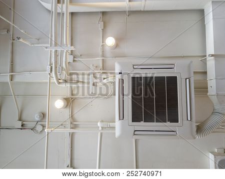 White Industrial Air Conditioner Cooling Pipe With Plumbing At Ceiling. Ventilation System Ceiling A
