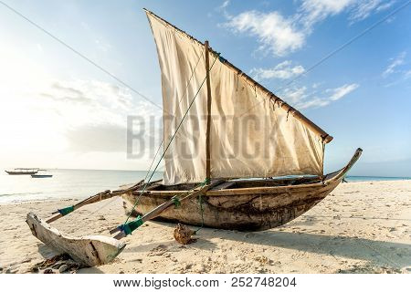 A Dhow Boat On The Beach. Sailing Boat On The Shore.