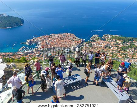 Dubrovnik, Croatia - August 4 2018: Tourists Looking Out Over Panorama View Of Old Town Histoic Unes