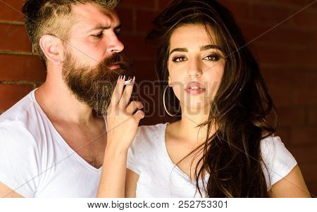 Couple In Love Hugs While Smoking Cigarette Brick Wall Background. Break Or Pause For Smoking. Coupl