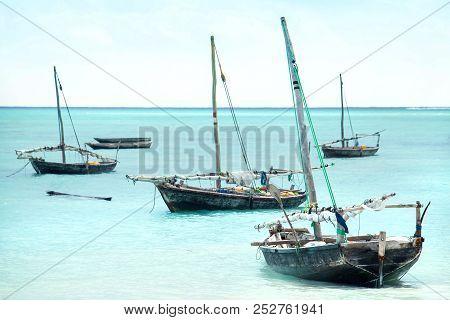 Dhow Boats In Zanzibar. Sailing Boats At Sea On Zanzibar Island.