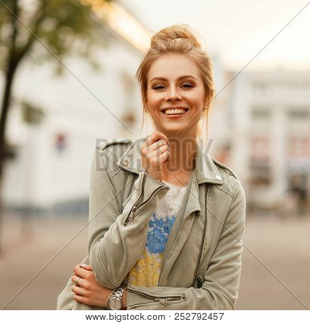 Fresh Funny Portrait Of A Beautiful Happy Woman With A Smile In A Fashionable Jacket In The City