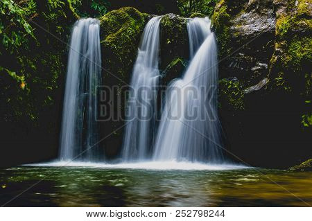 Waterfalls In Azores Always Provide A Very High Contrast Against The Lush Greens Of The Island. They