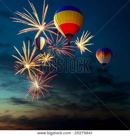 Fireworks And Hot Air-balloon At Sunset