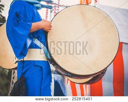 Drummer Performance, Taiko Drum, Japanese Folklore. Japanese Artist Perform At Bon Festival In Blue