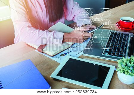 Business Woman Analyzing Financial Data On Smartphone And Laptop Computer. Business Analysis And Str