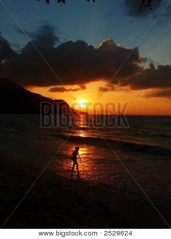 Woman Walking On The Beach At Sunset, Seychelles