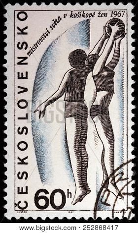 Luga, Russia - January 23, 2018:  A Stamp Printed By Czechoslovakia Shows Two Women Basketball Playe