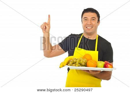 Smiling Fruiterer Pointing Upwards