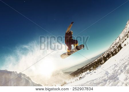 Snowboarder Jumps For Long Distance From Springboard