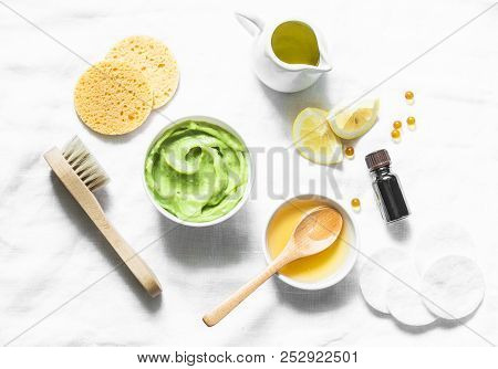 Honey And Avocado Face Mask On Light Background, Top View. Beauty, Youth, Skin Care Concept. Flat La