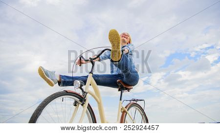 Woman Feels Free While Enjoy Cycling. Girl Rides Bicycle Sky Background. Cycling Gives You Feeling O