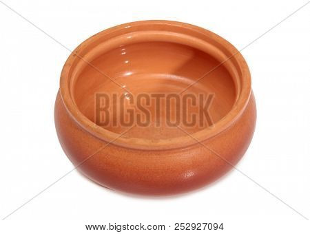Ancient ceramic pot on a white background