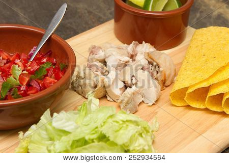 Mexican Cuisine Tacos Making Mexican Style Tacos With Chicken And Salsa, Tomatoes And Chillies.