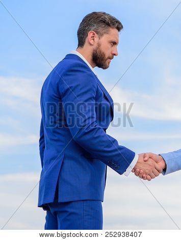 Sure Sign You Should Trust Business Partner. Man Formal Suit Shaking Hand Blue Sky Background. Busin
