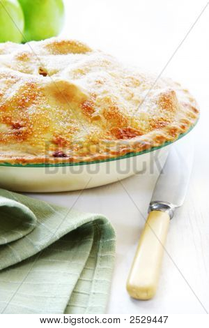 Home-baked apple pie straight from the oven. Vintage enamel pie plate and bone-handled knife. poster