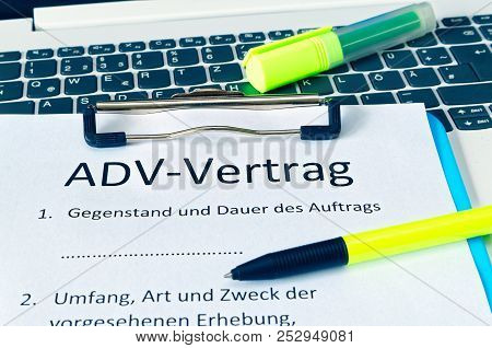 Clipboard With A Contract And Inscription In German Adv-vertrag In English Adv Contract And Subject