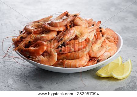 Big boiled shrimps in white plate close up. Seafood concept. Food photography