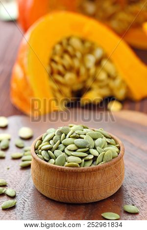 Pumpkin Seeds In A Bowl On The Table. Stock Photo