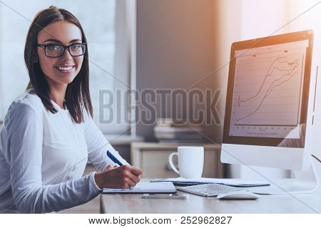 Happy Business Lady Using Computer And Smiling While Working In Office. Accountant Manager. Office A