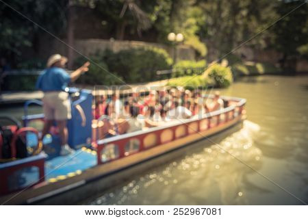 Vintage Blurred Tourists Riding Riverboat On River Walk In San Antonio, Texas