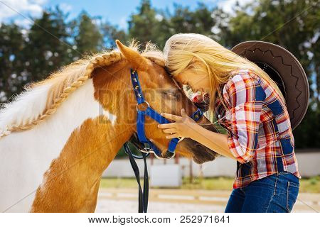 Caring Cowboy Girl Feeling Emotional While Seeing Her Cute Pony
