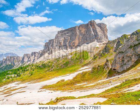Lastoni De Formin, Aka Ponta Lastoi De Formin. Giant Mountain Block With Blooing Meadow And Summer S