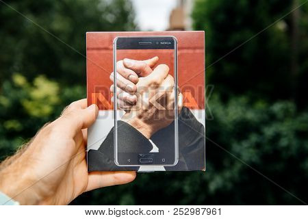 Paris, France - Aug 1, 2018: Man Hand Holding New Box Of Nokia 6 Android Smartphone Against Green Na