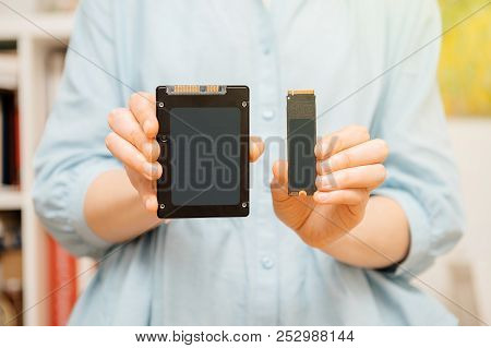 Woman Hands Holding New Nvme Pcie Ssd Hard Drive Disk With High Read And Write Speed Comparing To Ss