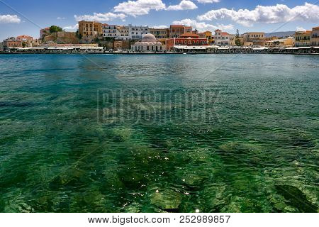 Old harbour of Chania with Venetian quay and Kucuk Hasan Pasha Mosque in the sunny morning, Crete, Greece poster