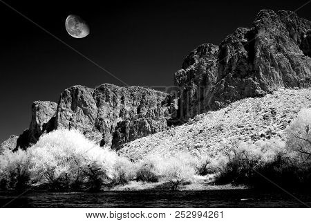 Infrared monochrome desert moon over the southwestern USA Sonora desert and Salt River Arizona and mountains poster