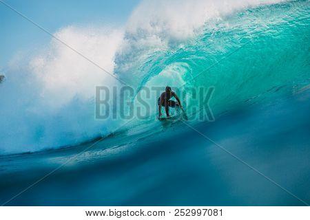 July 29, 2018. Bali, Indonesia. Surfer Ride On Barrel Wave. Professional Surfing In Ocean At Big Wav