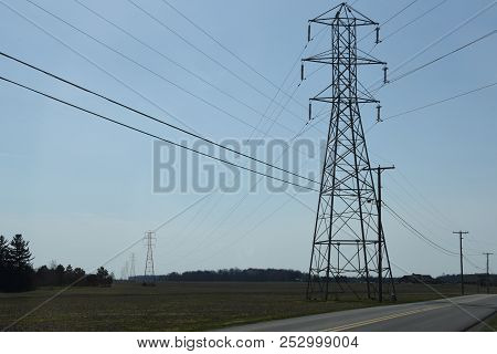 A 380 Kv Transmission Power Line Crossing Above A 25 Kv Distribution Power Line Under A Clear Blue S