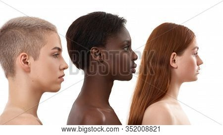 Profile Portrait Of Three Beautiful Multicultural Young Women.two Caucasian And African Half Naked W
