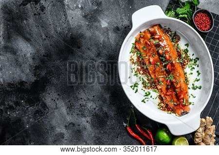 Cooking Of Salmon Fillet Teriyaki. Black Background. Top View. Copy Space