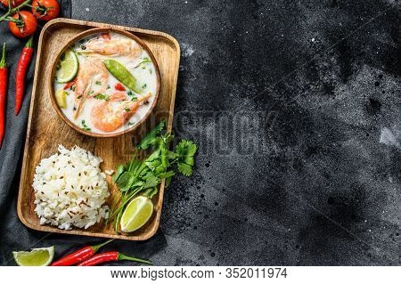 Homemade Tom Kha Gai. Coconut Milk Soup In A Bowl. Thai Food. Black Background. Top View. Copy Space